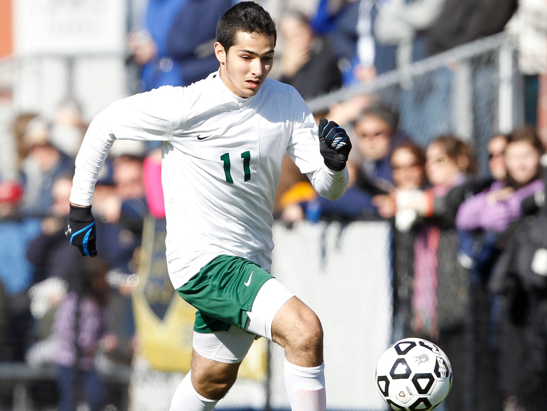 Solomon Schechter's Jonathan Rand (11) works the ball along the sideline during their 9-1 loss to Notre Dame in the NYSPHSAA boys class C soccer final at Middletown High School on Sunday, Nov. 15, 2015.