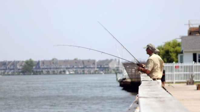 Dumm fishes off the free fishing zone between Second and Fourth streets in Ocean City.