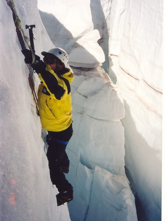 Andy Land Hanging on Ice.jpg