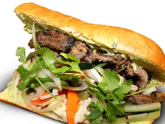 Bayou City Banh Mi LI blends vegetables and tasty meats.