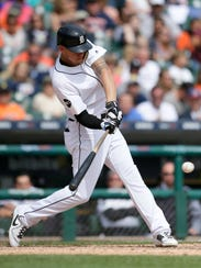 Tigers' JaCoby Jones singles against the Indians in