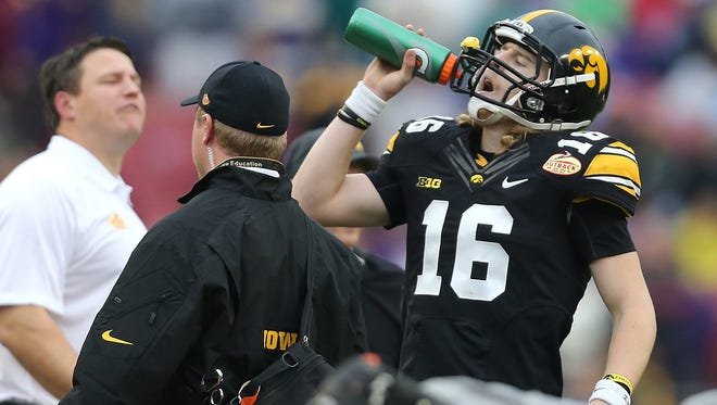 Iowa quarterback C.J. Beathard takes a drink of water during a timeout against LSU in the Outback Bowl on Wednesday, Jan. 1, 2014, in Tampa, Florida.