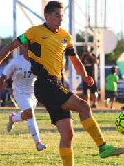 Alamogordo's Adam Foltz attempts a shot on goal near