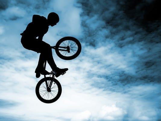 Man doing an jump with a bmx bike.