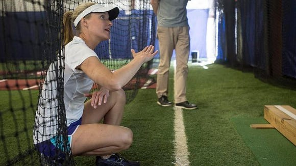 Christine Hornak instructs a student during a lesson Wednesday at the House of Fastpitch facility in Fletcher.