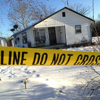 Police tape surrounds one of the crime scenes in Tyrone, situated in south-central Missouri.