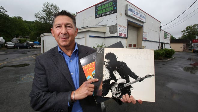 Michael Magnone of New City with his copies of Bruce Springsteen's first three albums at the Blauvelt Auto Spa. Magnone will be putting up a historical marker at the site, originally the 914 Sound Recording Studios, where the first two albums and the title track of the third were recorded.