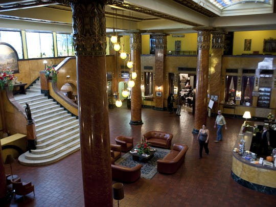The lobby of the Hotel Gadsden in Douglas features floor-to-ceiling marble pillars decorated in 14-karat gold leaf, a curving white-marble staircase and a Tiffany stained-glass mural that stretches 42 feet across one wall.