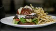 In LA, STK serves a signature burger with lettuce,