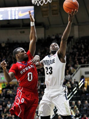 Jacquil Taylor in front of Howard's Dalique MIngo of Howard to put Purdue up 80-43 over the Bison at 7:26 in the second half Wednesday, December 9, 2015, at Mackey Arena. Purdue thumped Howard 93-55.