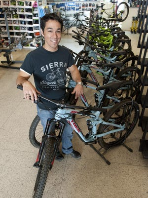 Shop Manager Rudy Maldonado shows some of the 14 bicycles available to rent at Sierra Bicycle Werks in Visalia on Tuesday, November 24, 2015. Rental payments can be applied toward purchase.