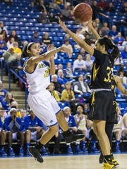 Delaware's Courtni Green throws the ball to the top of the key along the baseline in the second half of Delaware's 69-64 overtime win over Towson this season at the Carpenter Center.