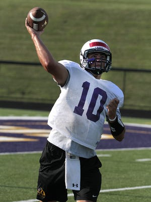 Quarterback Austin Hoeh works on accuracy during a passing drill.