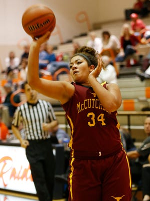 Taryn Elliott puts up a three point shot for McCutcheon in the Franciscan Health Hoops Classic Monday, November 13, at Harrison High School. McCutcheon defeated Twin Lakes 67-52.