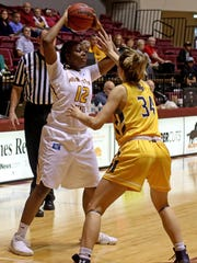 Midwestern State's Chelsea Adams passes in the game against Texas A&M-Commerce Saturday, Dec. 2, 2017, at D.L. Ligon Coliseum. The Mustangs defeated the Lions 69-66.