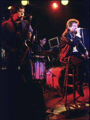 Ronnie Lane (right) and Bobby Keys on saxophone join the Tremors at the Steamboat on May 12, 1987, in Austin.