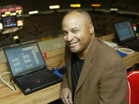 In this Feb. 28, 2003, Detroit Free Press columnist Drew Sharp poses at Joe Louis Arena. Sharp, a longtime Detroit sports columnist, died Friday, Oct. 21 2016, at his home in Bloomfield Hills. He was 56. Sharp joined the paper as a sports writer in 1983 and was named a columnist in 1999.