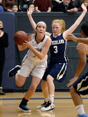 Pittsford Mendon's Sarah Stark, left, drives the baseline past Pittsford Sutherland's McKenna Davis during the Rainbow Classic at the University of Rochester on Friday, Jan. 19, 2018.