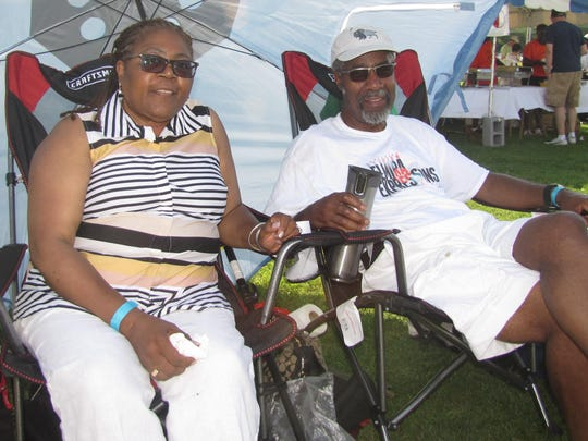 Roland A. Coleman II and his wife, Marjorie, of Buffalo enjoy shade and smooth jazz Saturday at the Ferrario Southern Tier Jazz Festival at Thorne Street Park in Horseheads.