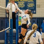 Wyoming senior middle hitter Haley Stewart makes a play at the net at Madeira on Sept. 15.