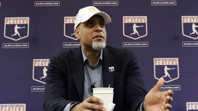 FILE - In this Feb. 19, 2017, file photo, Executive Director of the Major League Players Association, Tony Clark, answers questions at a news conference in Phoenix. Players' union head Tony Clark is guarding against drawing any conclusions about the free-agent market based on Manny Machado's contract and says Adam Wainwright's recent comments about a possible strike were in line with the level of concern he hears from the pitcher's colleagues. Clark met with the Los Angeles Angels on Thursday, Feb. 21, 2019, starting his spring training tour as several top players still look for teams.