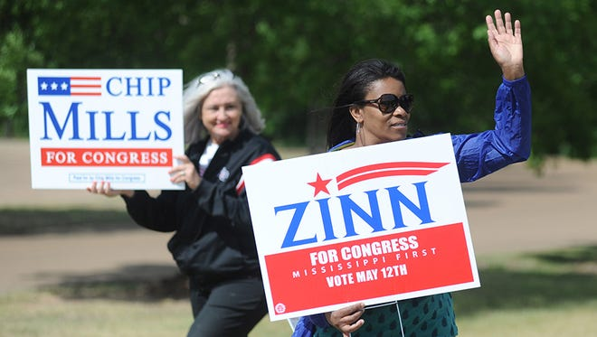 Margaret Bell holds a sign in support of candidate Walter Zinn and Vickie Holleman holds one in support of Chip Mills, during a special election for the 1st Congressional District, at the Oxford Conference Center in Oxford, Miss. on Tuesday, May 12, 2015. Thirteen candidates are vying for the seat previously held by Alan Nunnelee, who died in February 2015.