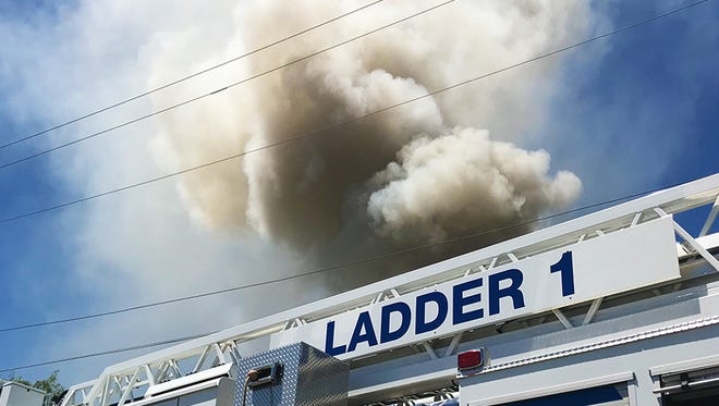 San Angelo Fire Department's Ladder 1 at the scene of structure fire at Ward Street and Milton street, Thursday, June 28, 2018.