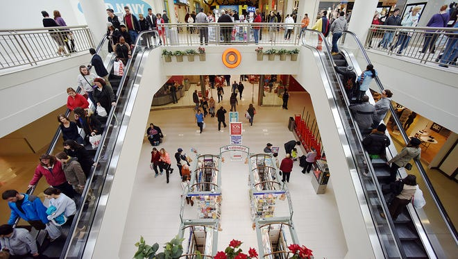 People shop on Friday at the Poughkeepsie Galleria in the Town of Poughkeepsie.