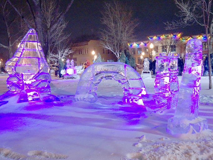 Colored lights illuminate the ice sculptures.