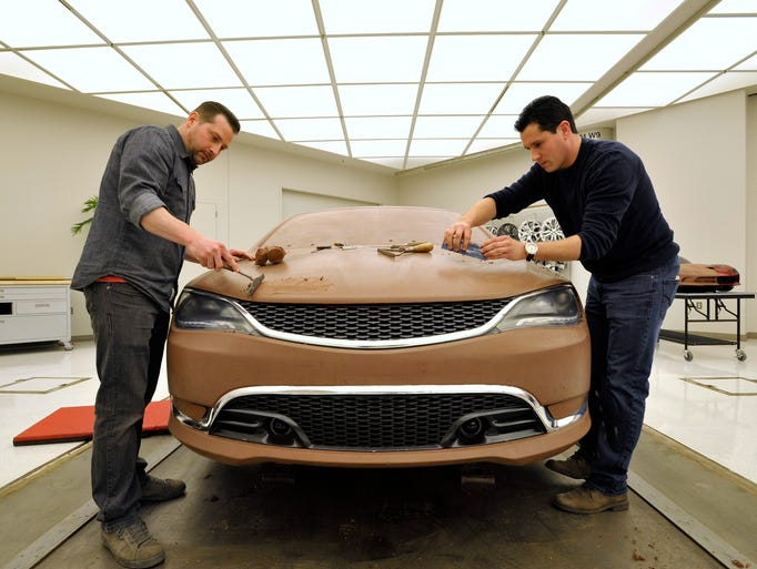 Clay modelers Todd Wilburn, left, 39, of Rochester,