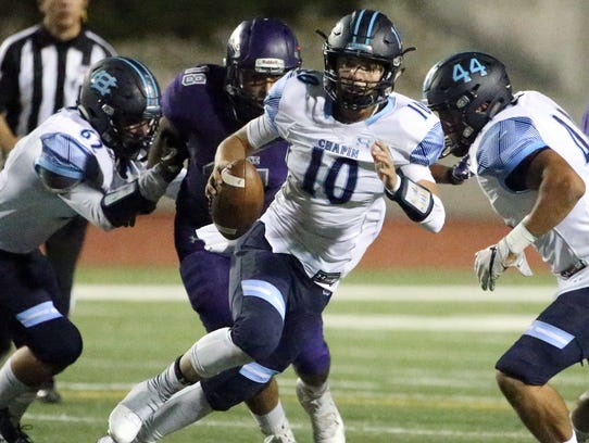 Chapin quarterback Anthony Baird, 10, scrambles while