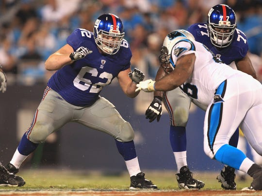 New York Giants lineman Mitch Petrus, left, during a preseason game against the Carolina Panthers on Aug. 13, 2011.