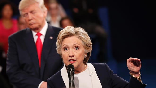 Democratic presidential nominee Hillary Clinton and Republican presidential nominee Donald Trump participate in a town hall debate at Washington University in St. Louis on Sunday.
