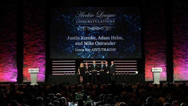 Green Bay air traffic Controllers Mike Ostrander, Justin Krenke and Adam Helm were honored on March 4, 2015, in Las Vegas, for their actions in saving a pilot in distress on Feb. 13, 2014.