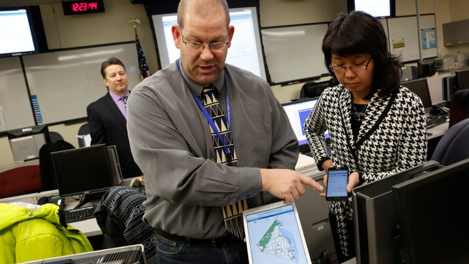 Scott Lounsbury and Zhujing Xia, with the Department of Planning, demonstrate the county's new interactive mapping and information application, which will allow residents to proactively plan evacuation routes in case of emergencies at the Indian Point Nuclear Power Plants.