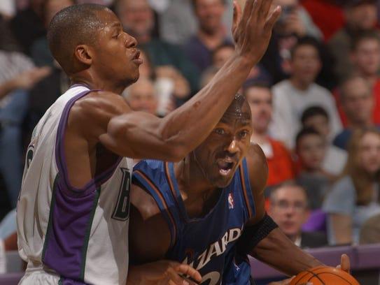 The Wizards' Michael Jordan drives against Bucks guard