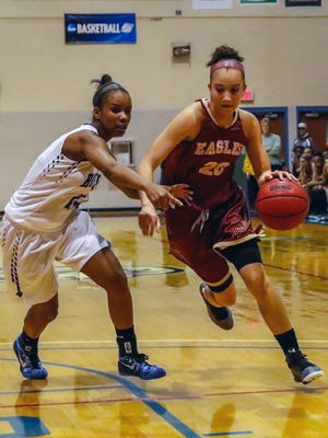 Brie Moore, right, a freshman on Bridgewater College's women's basketball team, has come all the way back from a devastating knee injury she suffered prior to her senior season at Waynesboro High School.
