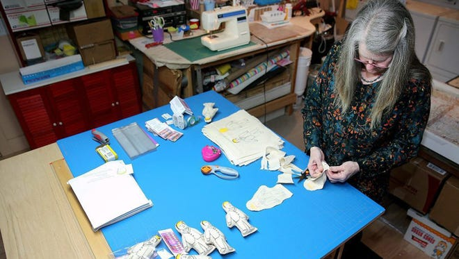 Sally Noedel of Bainbridge Island, Wash., struggles to keep up with orders for her Trumpy voodoo dolls, which are sold on Amazon and eBay