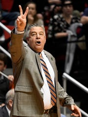 Auburn coach Bruce Pearl gestures during the first half of the team's second-round NCAA college basketball tournament game against Clemson on Sunday, March 18, 2018, in San Diego. (AP Photo/Denis Poroy)