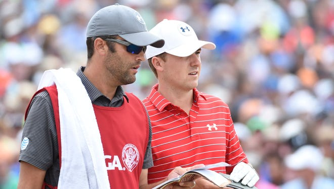 Jordan Spieth and caddie Michael Greller, left, in the first round of the 2015 U.S. Open at Chambers Bay.