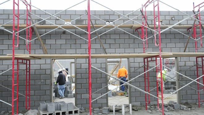 Workers build the first floor of Nolensville High School in January 2015. The school is scheduled to open in the fall.