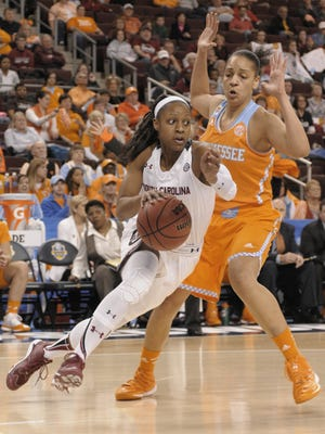 South Carolina guard Tiffany Mitchell, left drives past Tennessee forward Cierra Burdick, right, during first-half action of the Southeastern Conference tournament NCAA college basketball final game in North Little Rock, Ark., Sunday, March 8 , 2015.