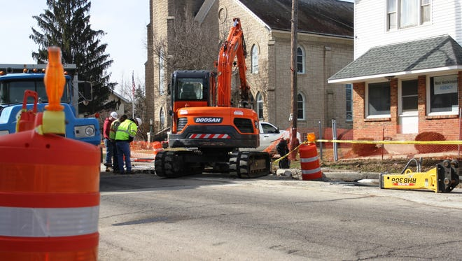 A work crew inspects an element of the ongoing Main Street improvement project. City officials recently provided an update on the project. The completion date is April 4, but that date could be moved, they said.