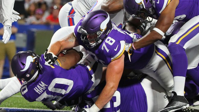 Minnesota Vikings running back C.J. Ham (30) rushes for a touchdown during the second half of a preseason NFL football game against the Buffalo Bills Thursday, Aug. 10, 2017, in Orchard Park, N.Y.