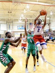 Woodlawn's TraMichael Moton drives to the basket during