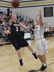 Beech's Jana Claire Swafford shoots while guarded by