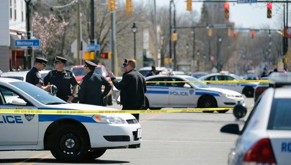 Police investigate a shooting at Frost and Jefferson avenues on Wednesday, April 20, 2016.