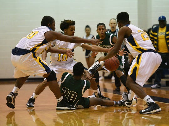 UPSET OF THE WEEK: No comeback for Parkside against Pocomoke as the Warriors defeated the Rams 83-69 thanks to their swarming defense shown above. Parkside's Gary Briddell tries to pass a loose ball to Juwan Williams as Pocomoke defenders Licurtis Whitney, Tyler Nixon and Amonty Allen move in.