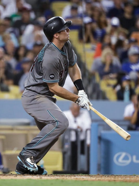 Arizona Diamondbacks' Paul Goldschmidt watches his three-run double during the seventh inning of a baseball game against the Los Angeles Dodgers, Friday, July 29, 2016, in Los Angeles. (AP Photo/Jae C. Hong)