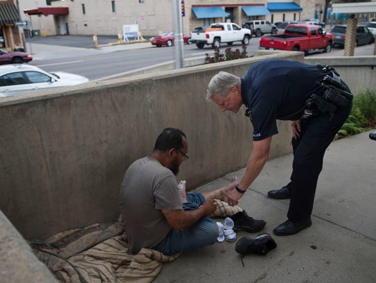 Loveland Police Sgt. Bob Shaffer checks on a homeless